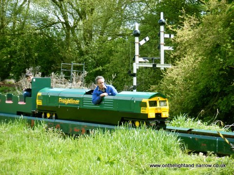 Gavin Motley takes Keal Carrier over the bridge into the station at Kirkby Green.
