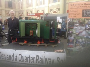 "Aiden Favell with ""Coughing Polly"" on the Society stand at the 2014 London Engineering Exhibition."